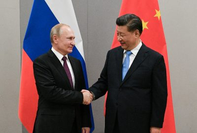 Russian President Vladimir Putin shakes hands with Chinese President Xi Jinping during their meeting on the sidelines of a BRICS summit, in Brasilia, Brazil, 13 November 2019 (Photo: Reuters).