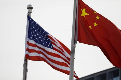 Chinese and U.S. flags flutter outside the building of an American company in Beijing, China 21 January 2021 (Photo: Reuters/Tingshu Wang).
