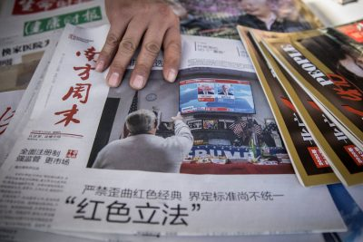 The front page of the Southern Weekly newspaper shows a picture of Donald Trump and Joe Biden at a newsstand in Beijing, China, 9 November 2020 (Photo: Reuters/Thomas Peter).